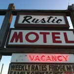 The sign that welcomes travelers to the Rustic Motel