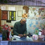 Bob Desai does some paperwork at the front desk of the Rustic Motel.